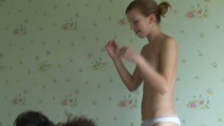 Two naked chicks provide a cock with a blowjob and handjob