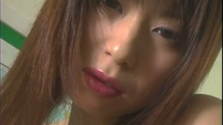 Saucy Japanese student Yuria Yoshinaga gets horny in a lecture room and masturbates right there