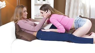 Passionate lesbians licking on the sofa