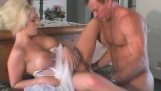 Busty blonde Jamie Brooks spreading her legs for cunnilingus